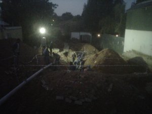 Finishing the pour under floodlights.