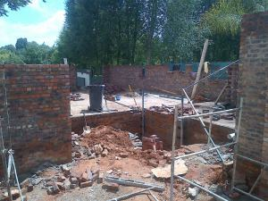 East wall of kitchen and living room going up.  The bin is standing in the entrance hall.