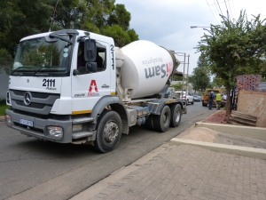 Cement truck in the street.
