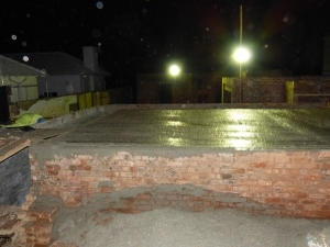 Here you can see some of the floodlights and they are illuminating the concrete that has been cast to form the floor of the cottage.