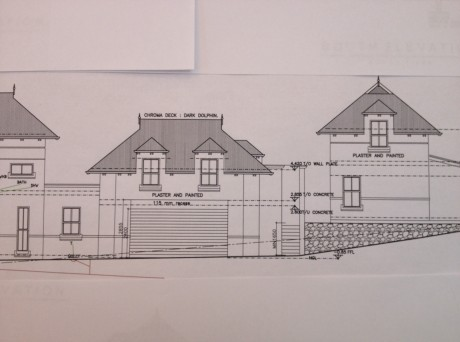 Revised plan showing two dormer windows above the garage and one facing west in the cottage roof.