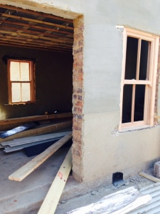 Windows being installed in the cottage.