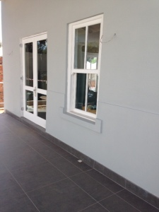 Cottage has been painted and the veranda tiled.