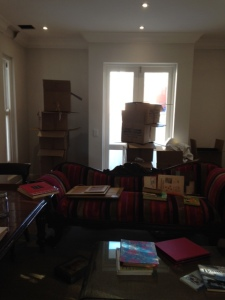 Unpacking books in the library.  All those boxes are already empty.