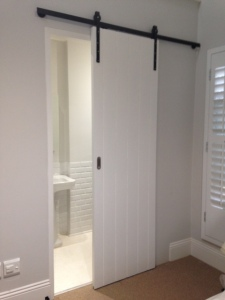 Barn sliding door in bedroom 3.